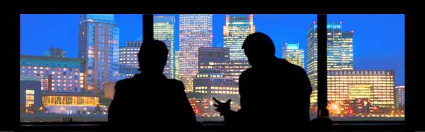 two men talking with a city backdrop