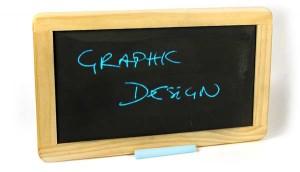 graphic design written on a blackboard in blue