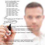 designer coding a website