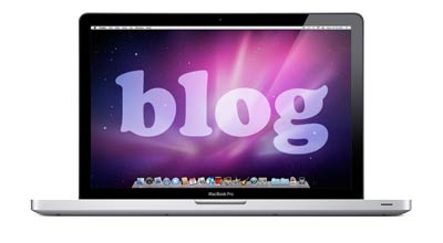 laptop with the word blog on it
