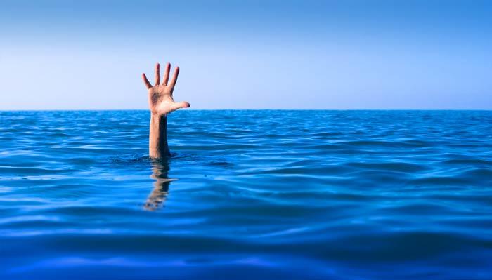 man's hand in a big blue sea