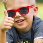 boy giving thumbs-up
