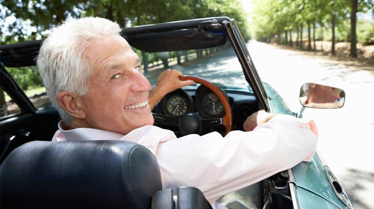 old man in a sports car