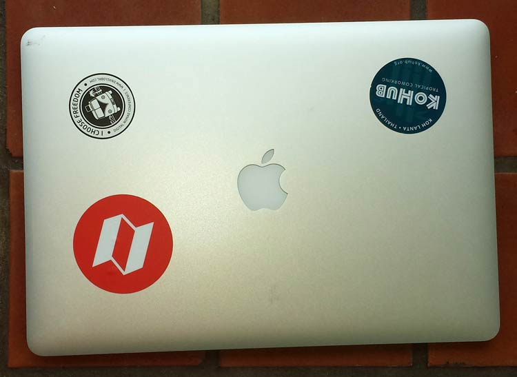 macbook-pro-with-digital-nomad-stickers