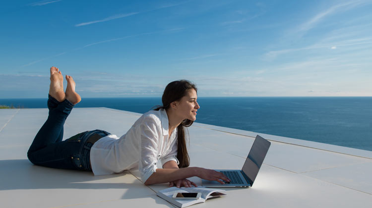 lady with laptop by the sea learning How To Monetize A Blog and how to Generate Income On Your Site.jpg